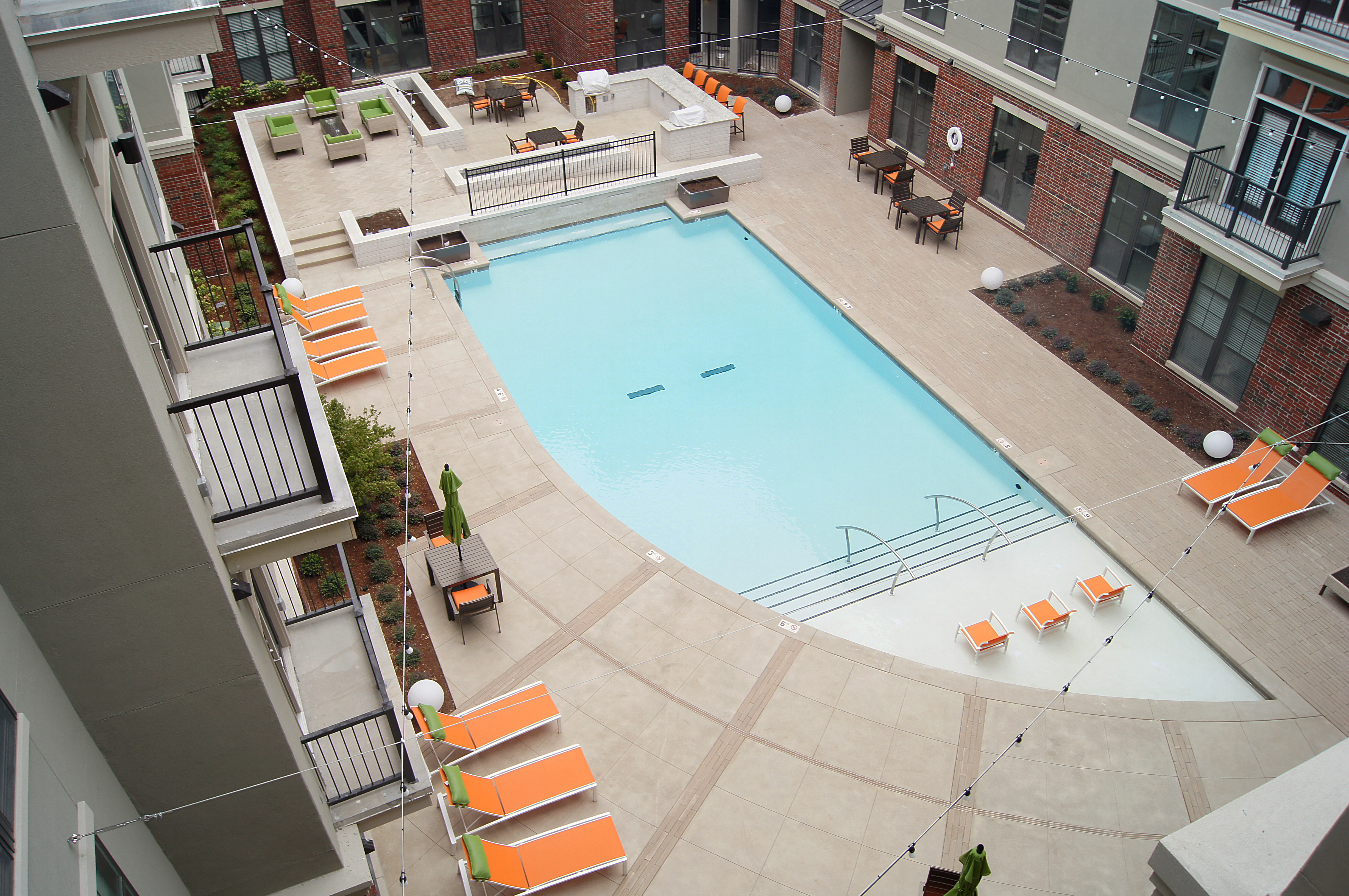 Marvelous ... The Edge Luxury Apartments In Tulsa Installed Bomanite Exposed  Aggregate Alloy System Concrete Pool Deck