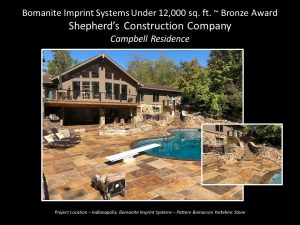 Shepherds Construction designed a private residence stamped concrete backyard