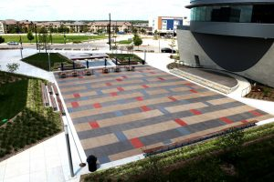 Lenexa Civic Center Festival Plaza incorporates Bomanite Sandscape Texture Exposed Aggregate System with Bomanite Con-Color Staining Techniques