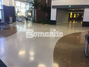 Infinite Campus used Bomanite Custom Polishing Systems Modena Monolithic and Renaissance Deep Grind to create a Natural looking Floor with a Beach Vibe