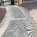 Canobie Lake Park, Castaway Island Expansion by Harrington Bomanite installation of the drainage walkway meandering brook Stamped with Bomacron Garden Stone Pattern Decorative Concrete