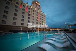 Hard Rock Casino located in Tulsa, OK makes waves with Bomanite Exposed Aggregate Alloy Finish for the Stylish, Architectural Concrete Pool Deck in two Bomanite Color Hardener and Integral Color Geometric shapes installed by Bomanite of Tulsa, Inc.