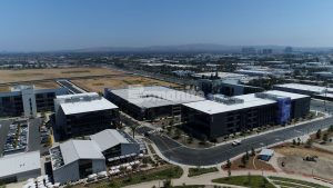 Flight at Tustin Legacy, a business development campus located within distance of the one of a kind blimp hangar wood structures, creates living working office environments with Bomanite Revealed Exposed Aggregate landscaped pedestrian walkways, courtyards and outdoor work spaces