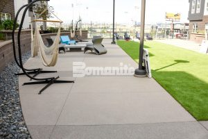 CoLab Cohousing located in Denver, Colorado created a stylish student living community with Bomanite Bomanite Sandscape Textured Walking Paths designed with different colors to create a modern pattern