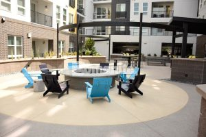 CoLab Cohousing located in Denver, Colorado created a stylish student living community with Bomanite Sandscape Refined installed around the board formed firepit