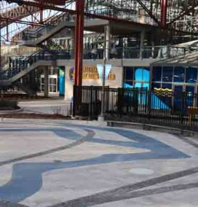St. Louis Aquarium at Union Station Creates River of Glass with Bomanite Revealed Exposed Aggregate for the River Confluence created by PGAV Destinations and installed by Musselman & Hall Contractors for the Aquarium Train Station Themed Entry Way