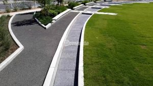 Owasso Redbud Festival Park used a custom Bomanite Chipped Shale Imprint for a stylized streambed that incorporated a splashpad designed by GH2 Architects and installed by Bomanite of Tulsa for the Owasso Community to enjoy
