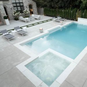 The Homeowners sought out Bomanite Toronto in Canada for a sleek backyard pool deck using the Bomanite Sandscape Refined Exposed Aggregate System