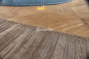 Using the Bomanite Imprint Systems Musselman and Hall Contractors worked with PGAV Destinations in creating a custom Hexagon Boardwalk pattern with Custom Radius Boardwalk boards that snake around the entrance to the Branson Boardwalk Aquarium.