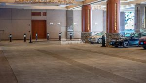 Monarch Casino Black Hawk Colorado Built a Luxury Port Cochere with Radiant Heat System installed under a Bomanite Decorative Imprinted Concrete Flooring in a Slate Texture with warm color tones provided by Bomanite Licensee Colorado Hardscapes